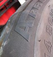 Bulging tyre caused by impact